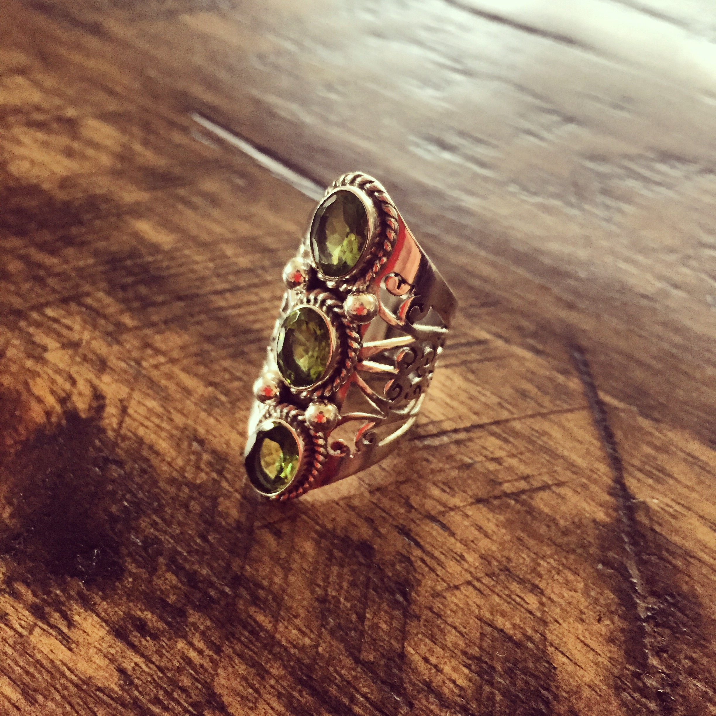 Three Peridot stones Ring