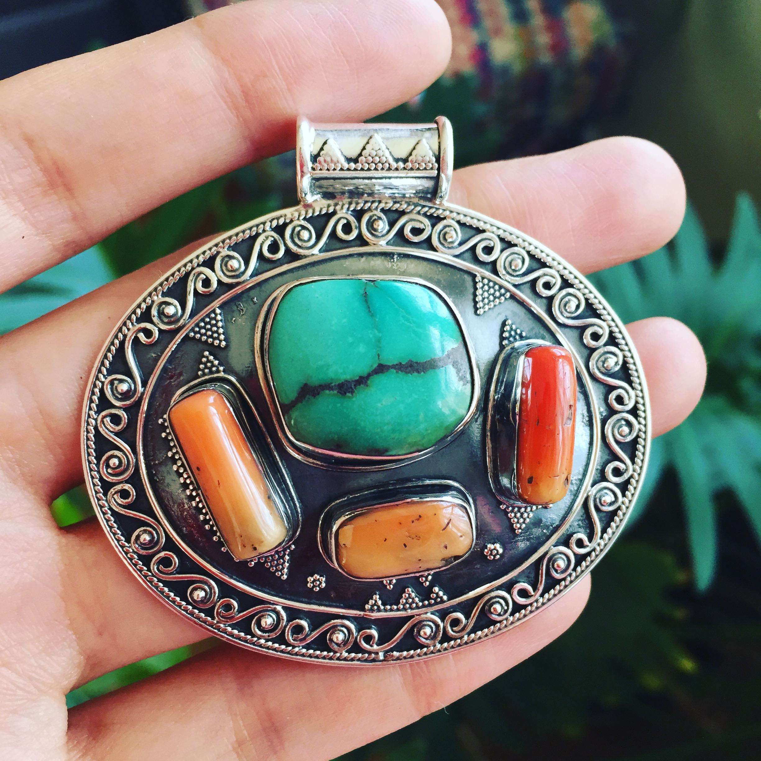 Sterling silver pendant with turquoise and coral stones