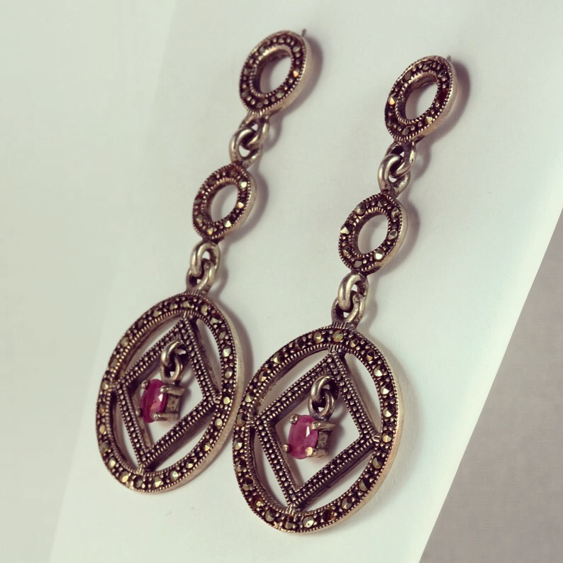 Time circles sterling silver earrings with ruby semi precious stones in the middle
